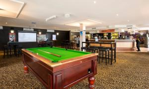 A pool table at Nightcap at Ferntree Gully Hotel Motel