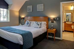 A bed or beds in a room at Wild Pheasant Hotel & Spa, BW Signature Collection