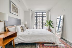 A bed or beds in a room at 138 Bowery