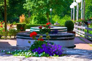 Ein Garten an der Unterkunft Oste-Hotel Superior