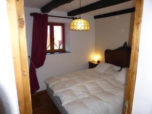 Een bed of bedden in een kamer bij La Maison Chouette