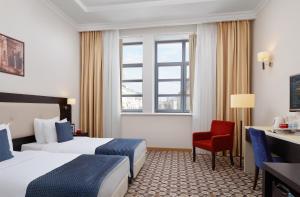 Кровать или кровати в номере Отель Ногай