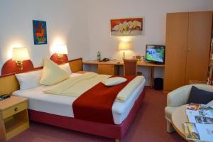 Ein Bett oder Betten in einem Zimmer der Unterkunft HANSA Hotel