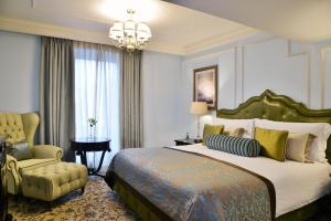 A bed or beds in a room at Taj Cape Town