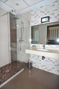 A bathroom at Hotel Ciudad de Plasencia