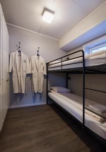 A bunk bed or bunk beds in a room at Coal Miners' Cabins