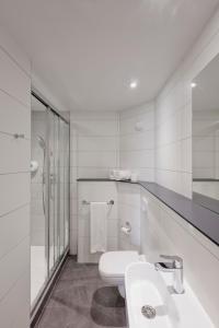 A bathroom at Première Classe Lyon Centre Gare Part Dieu