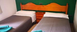 Cama o camas de una habitación en Bungalows Castillo Club Lake