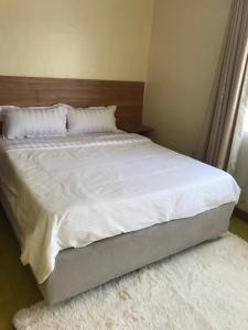 A bed or beds in a room at PottersVilla Furnished Apartment