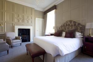 A bed or beds in a room at Headlam Hall Hotel