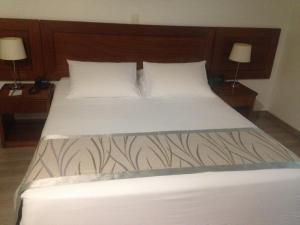 Cama ou camas em um quarto em Matsubara Hotel São Paulo