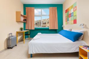 A bed or beds in a room at Abraham Hostel Jerusalem
