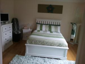 A bed or beds in a room at Strathaven Luxury Apartments