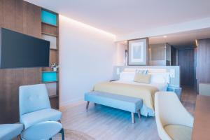 A television and/or entertainment center at Iberostar Selection Llaut Palma