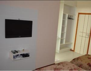 A television and/or entertainment center at Hotel Paradouro
