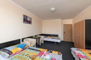 Postel nebo postele na pokoji v ubytování Hotel Buly