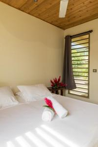 A bed or beds in a room at Villa Vai-Api