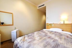 Tempat tidur dalam kamar di Hotel Sapporo Sun Plaza