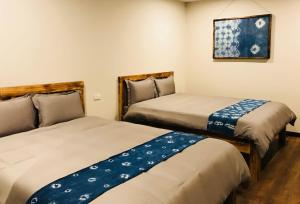 A bed or beds in a room at Fansipan Terrace Cafe and Homestay