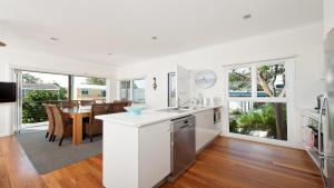 A kitchen or kitchenette at No. 1 Fingal Bay Beach House - The Little Abode