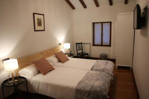 Cama o camas de una habitación en Casa Rural Iruso