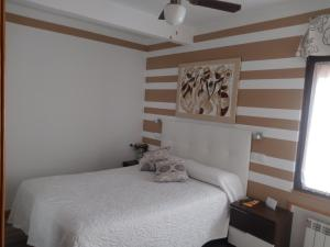 A bed or beds in a room at Don Diego