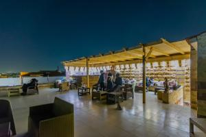 A restaurant or other place to eat at Panorama Pyramids Inn