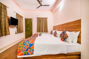 FabHotel Radha Residency Kottakuppamにあるベッド