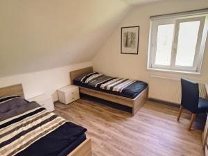 Ein Bett oder Betten in einem Zimmer der Unterkunft Ampflwang Apartments