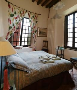 Letto o letti in una camera di Room & Breakfast Nel Borgo Scipione