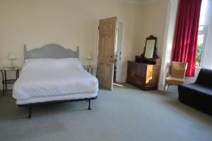 A bed or beds in a room at Furtho Manor Farm