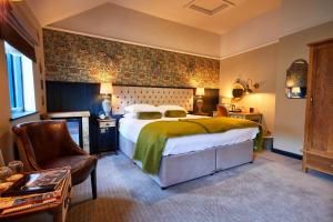 A bed or beds in a room at The Fleece at Cirencester