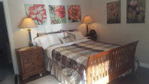 A bed or beds in a room at By the Sea BnB, Sidney Victoria BC