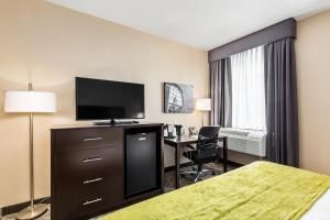 A television and/or entertainment center at Best Western Plus Philadelphia-Pennsauken Hotel