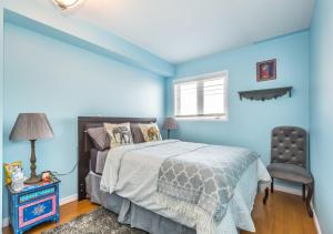 A bed or beds in a room at Affordable Guest Home at York U