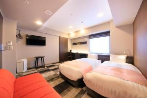A bed or beds in a room at S-peria Inn Osaka Hommachi