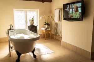 A bathroom at The Barns Hotel