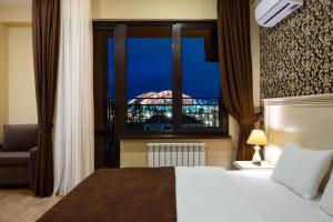 Кровать или кровати в номере MODART Olympic Hotel & Beach