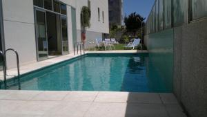 The swimming pool at or near Aparthotel Diamant Blue