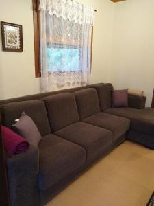Uma área de estar em Entre Vilas Lodge