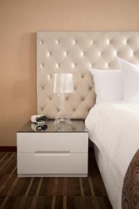 Un ou plusieurs lits dans un hébergement de l'établissement NM Lima Hotel