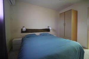 A bed or beds in a room at EIlon Hostel B&B