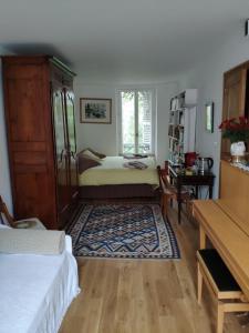 Postel nebo postele na pokoji v ubytování B&B terrasse et jardin