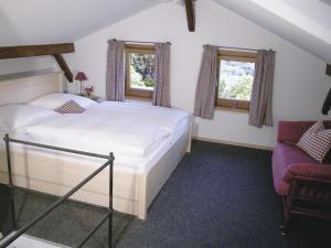 Ein Bett oder Betten in einem Zimmer der Unterkunft Rostalm