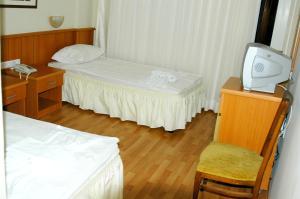 Кровать или кровати в номере Hotel Luna Piena