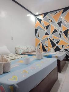 Cama o camas de una habitación en OYO 689 Mando Mango Inn