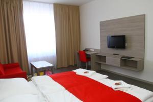 Postel nebo postele na pokoji v ubytování Hotel Palác Elektra