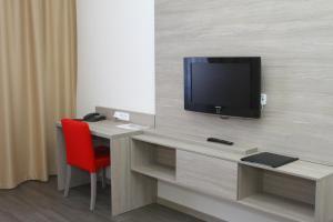 TV a/nebo společenská místnost v ubytování Hotel Palác Elektra