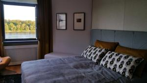 A bed or beds in a room at The View Torun