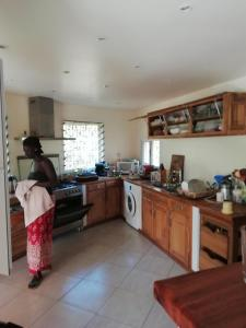 A kitchen or kitchenette at Villa Pat & Diouma